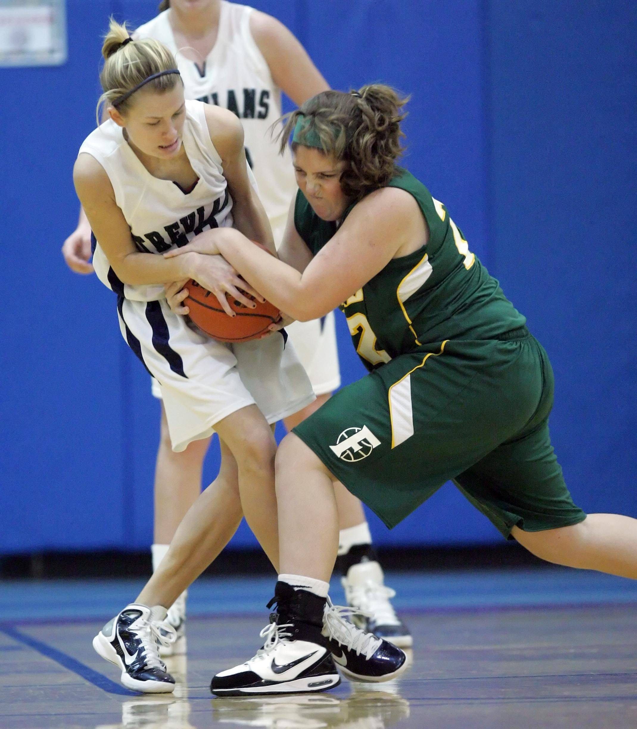 New Treir's Meg Rosinski, 10, wrestles with Fremd's Megan Horn, 22, during Fremd vs New Trier in the Third place game of the Charger Classic girls basketball tournament at Dundee-Crown High School in Carpentersville Thursday, December 30, 2010.