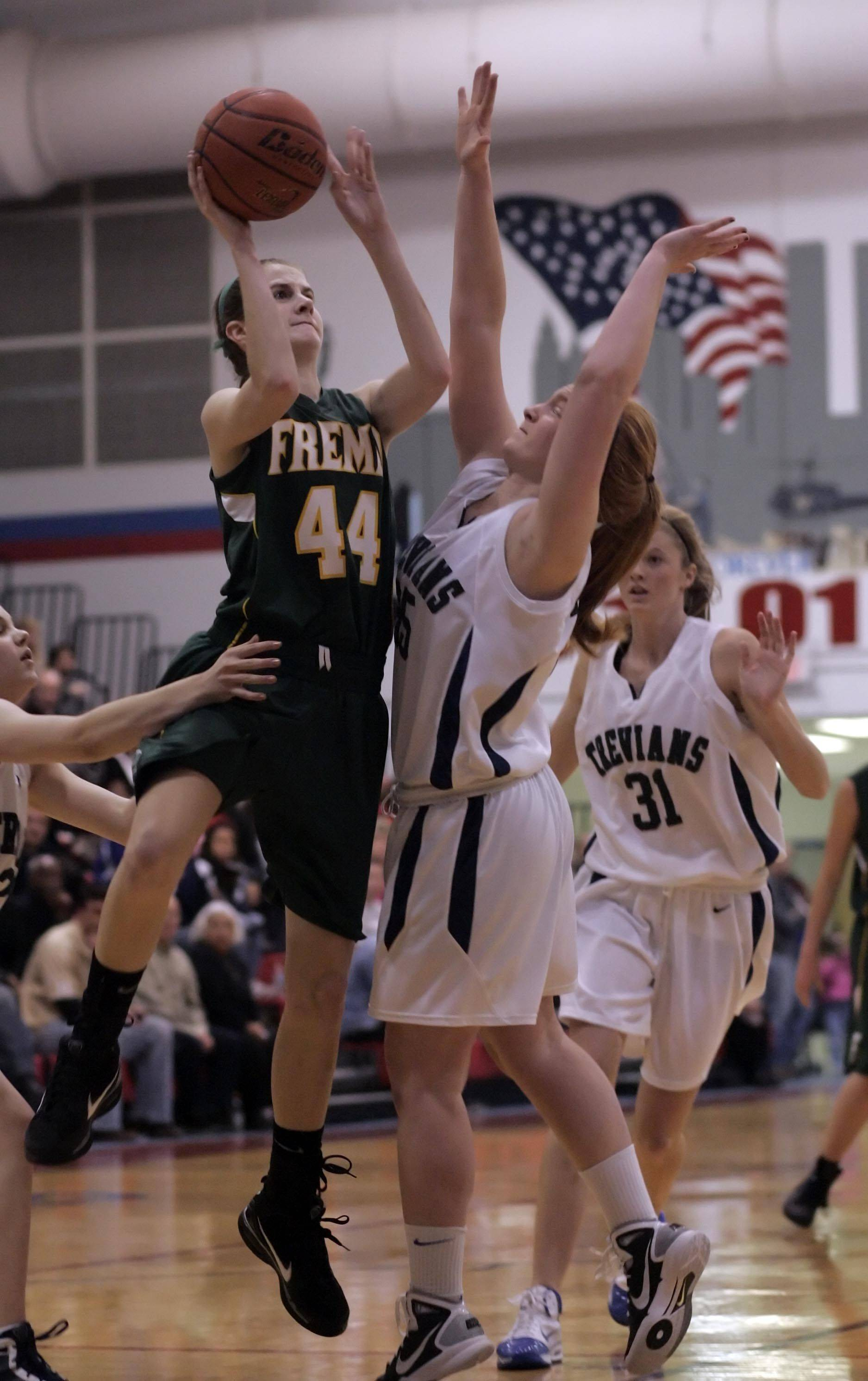 Fremd's Jessi Wiedemann 44, goes to the hoop over New Trier's Jessica Blackwell, 35, during Fremd vs New Trier in the Third place game of the Charger Classic girls basketball tournament at Dundee-Crown High School in Carpentersville Thursday, December 30, 2010.