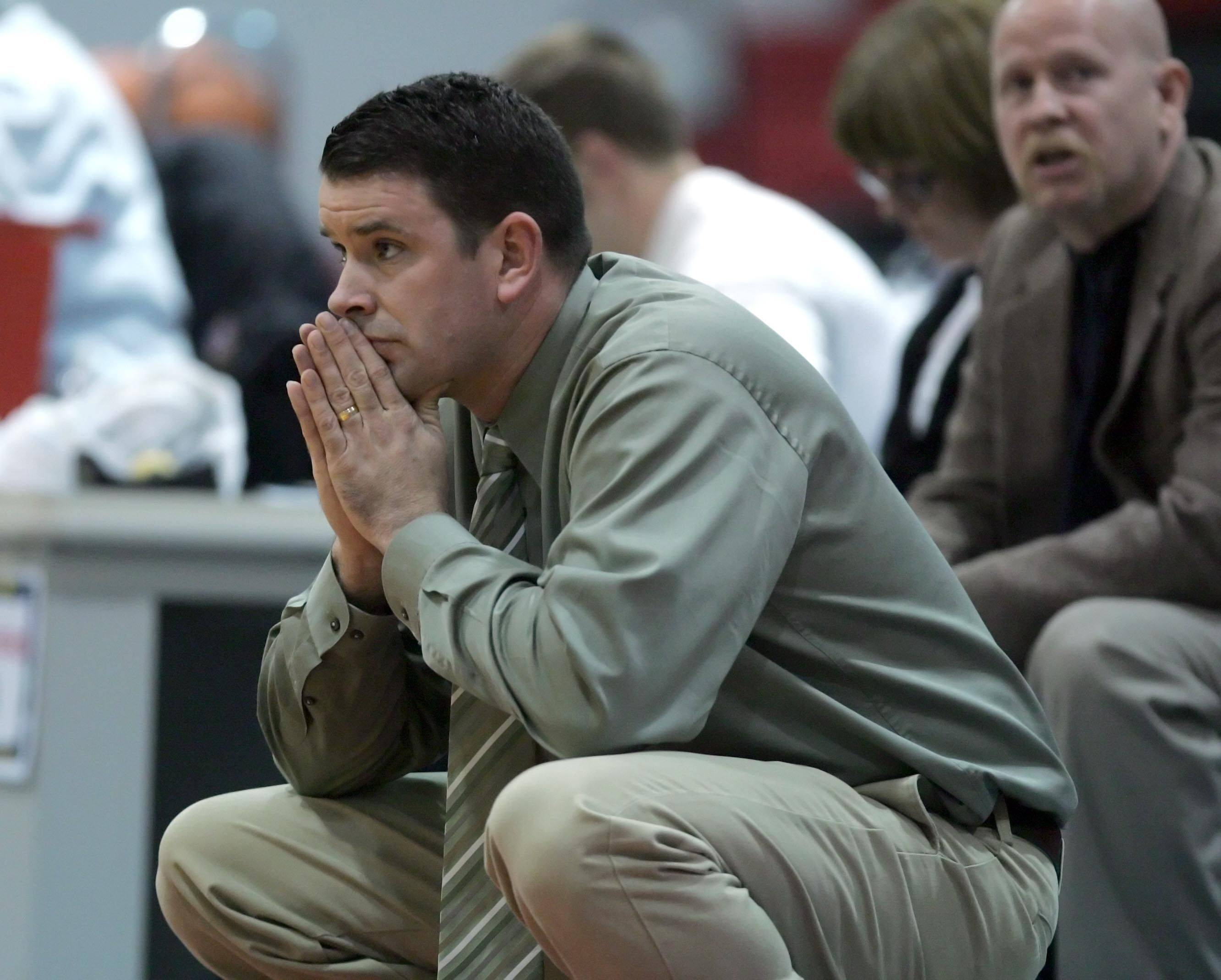 Fremd coach Dave Yates watches his team during the last quarter of Fremd vs New Trier in the Third place game of the Charger Classic girls basketball tournament at Dundee-Crown High School in Carpentersville Thursday, December 30, 2010.