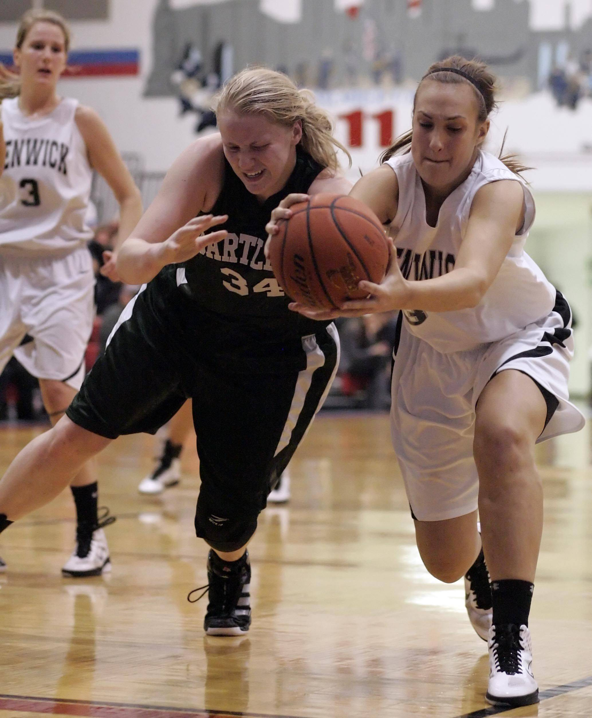 Bartlett center/forward Christina Carlson (34) battles Heather Casper, 33, for a rebound during Bartlett vs Fenwick in the Championship game of the Charger Classic girls basketball tournament at Dundee-Crown High School in Carpentersville Thursday, December 30, 2010.