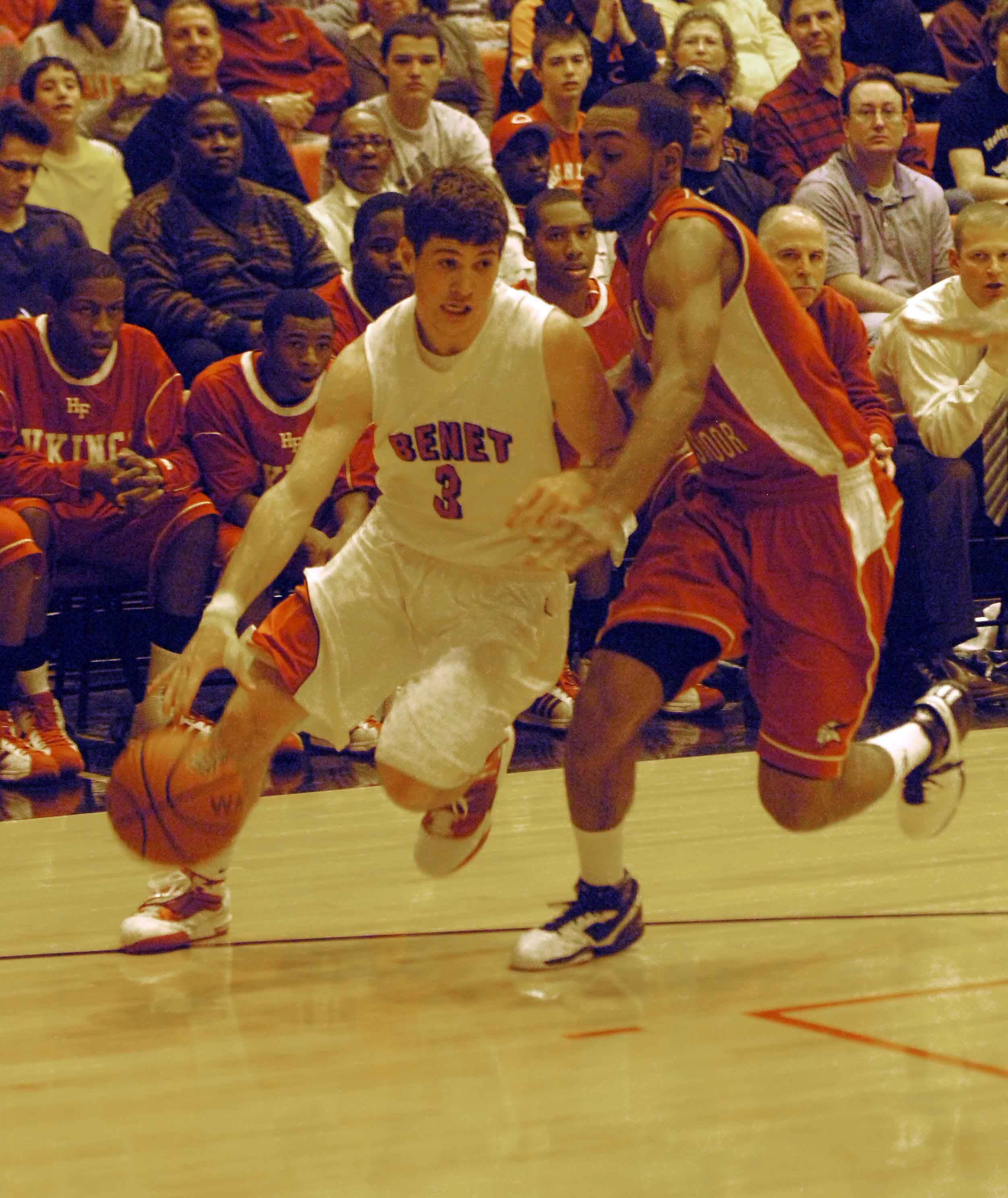 Dave Sobolewski moves the ball around Julian Lewis of Homewood-Flossmoor during the Benet vs. Homewood-Flossmoor game at Proviso West High School in Hillside Thursday.