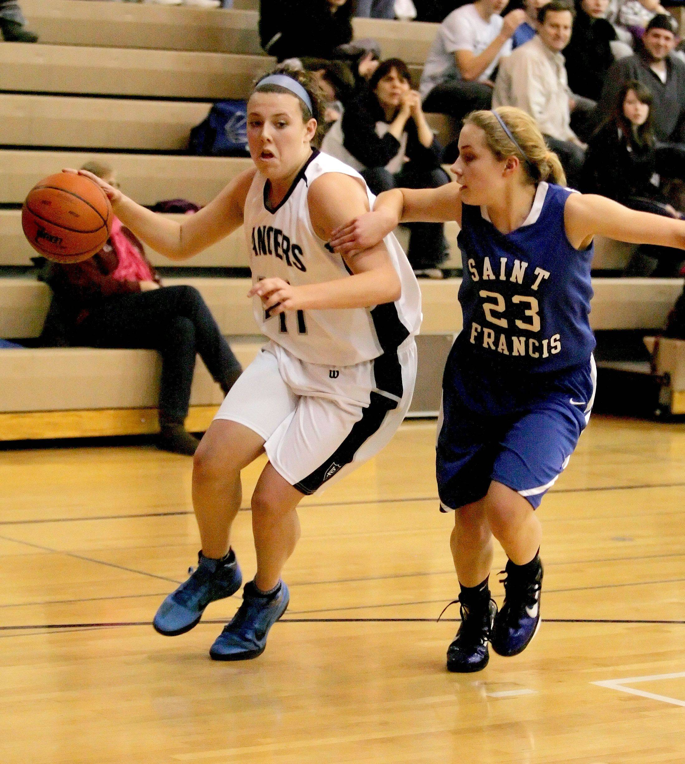 Alexis Hahn, left, of Lake Park moves around Kelly Reinke of St. Francis.