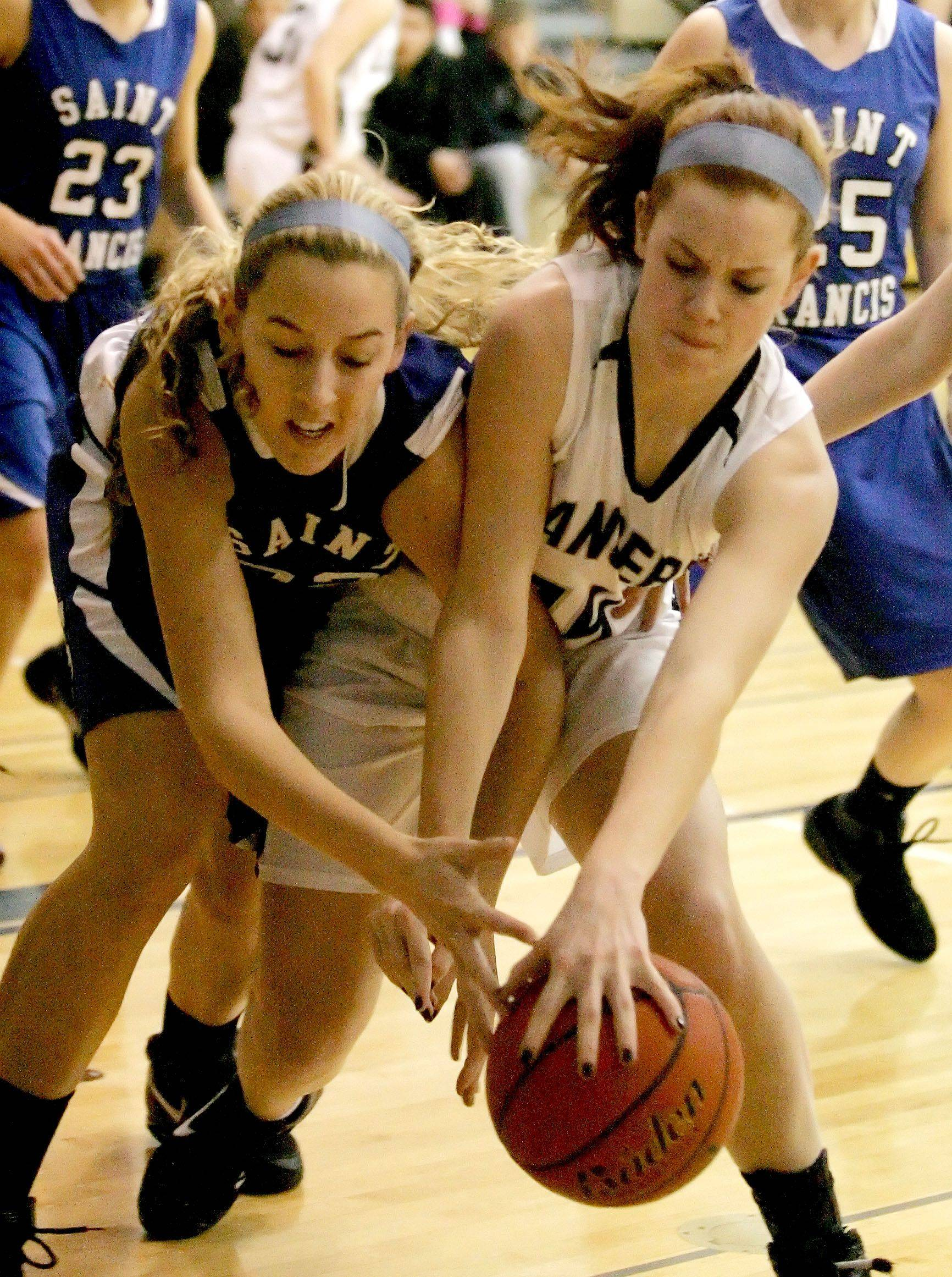 Fiona McMahon, left of St. Francis and Nicole Moore of Lake Park, right, go after a loose ball.
