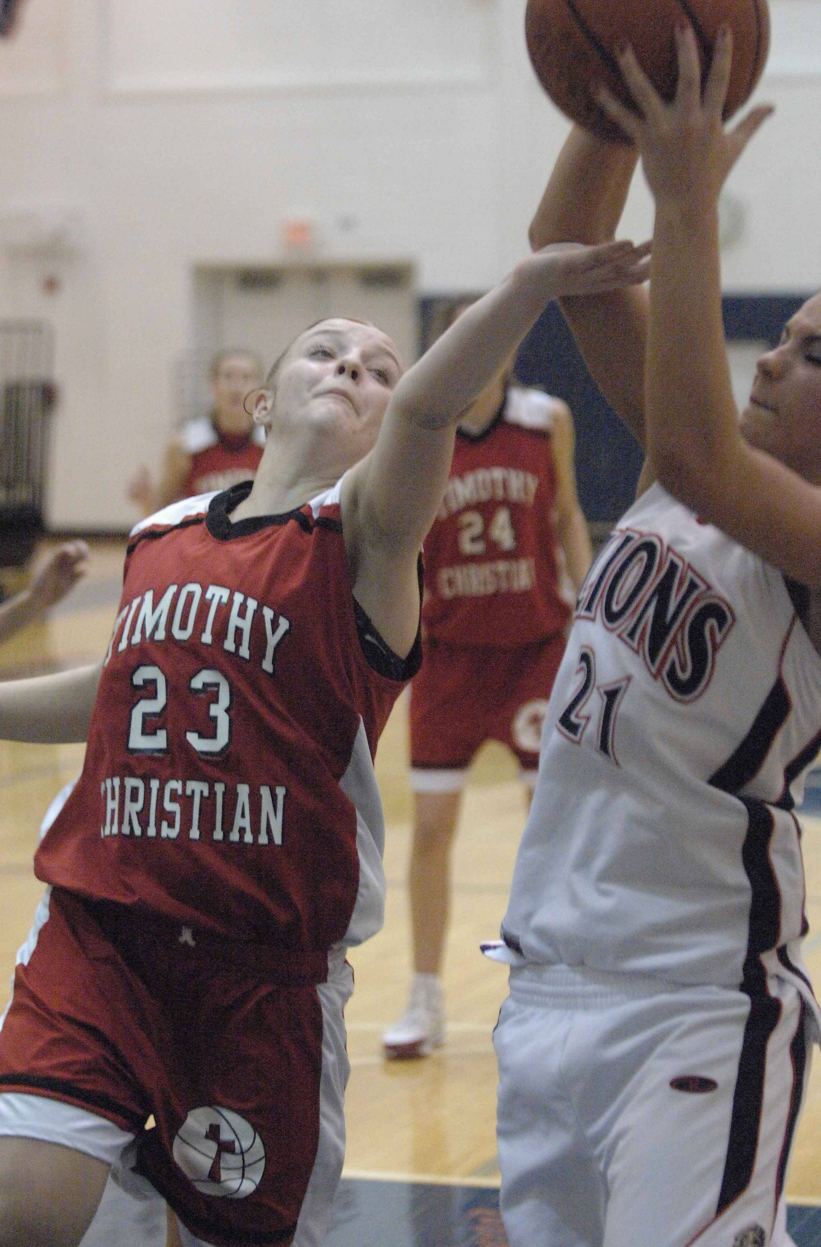 Elene Denny of Timothy Christian and Lisle's Kelly Urban during game action Wednesday.