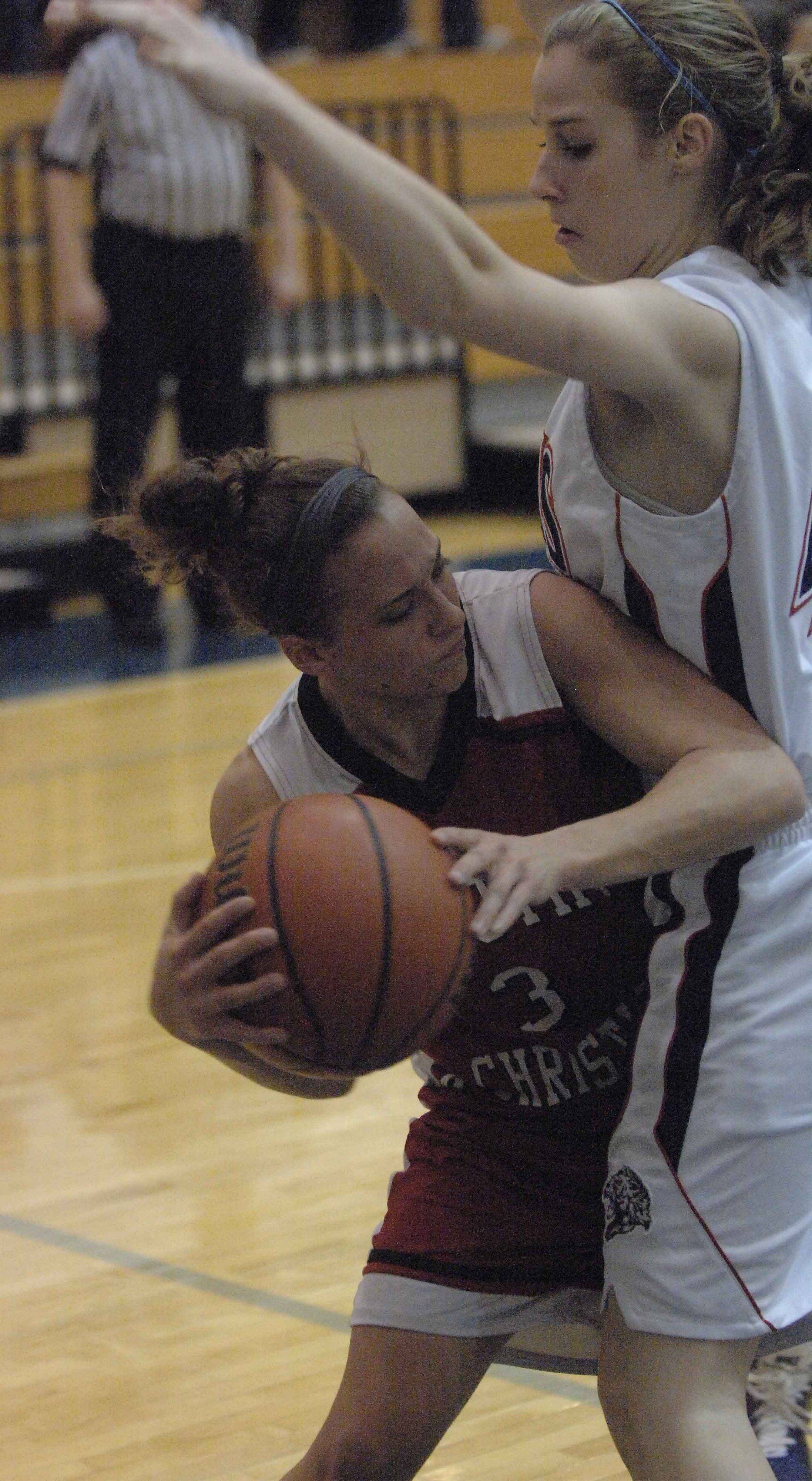 Jordyn Platt of Timothy Christian looks for an open teammate around Lisle's Tara Sarb .