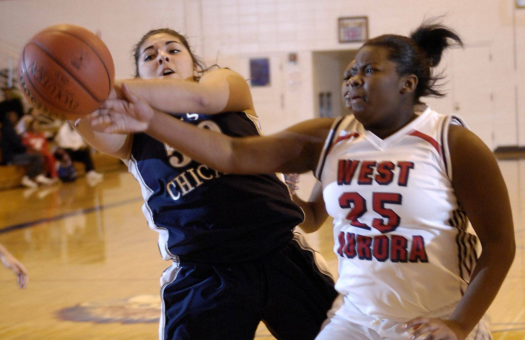 West Chicago's Amber Del Rio and West Aurora's Jonica Walker battle for a rebound .