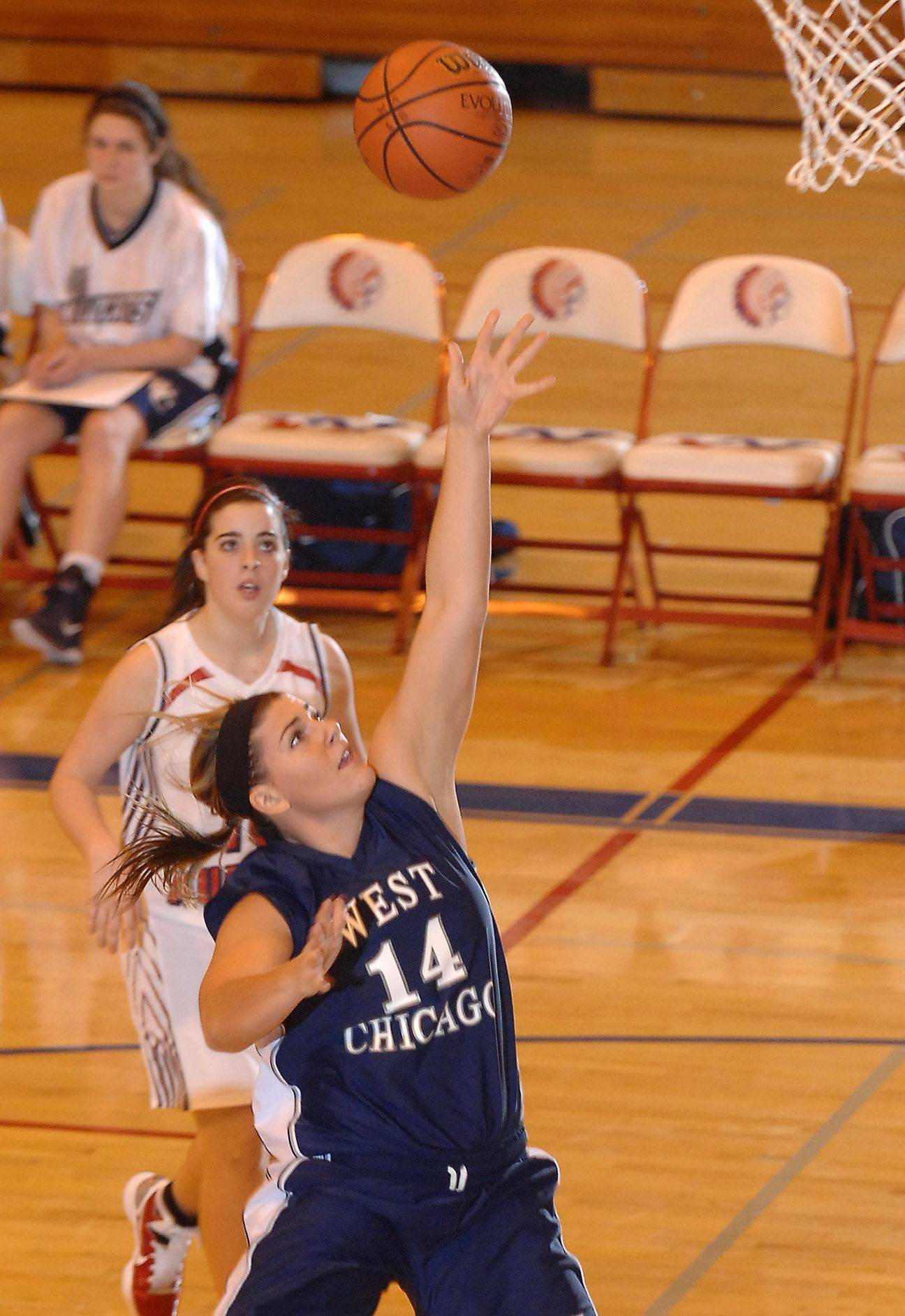 West Chicago's Mary Connolly puts up a running one-hander against West Aurora .