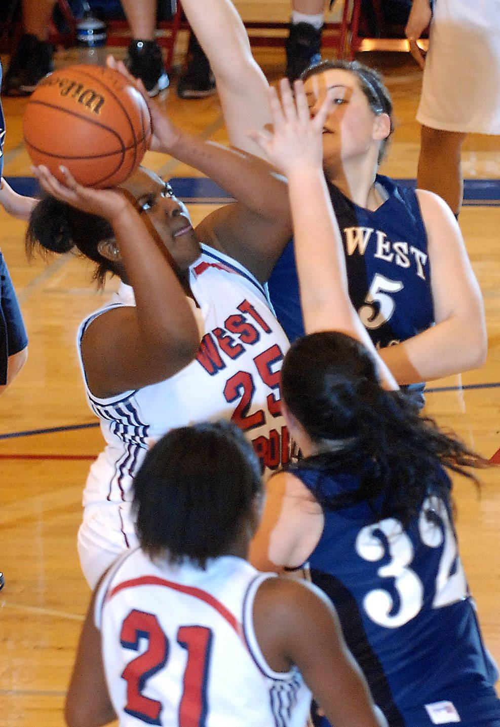 West Aurora's Jonica Walker puts up a shot in a crowded lane.