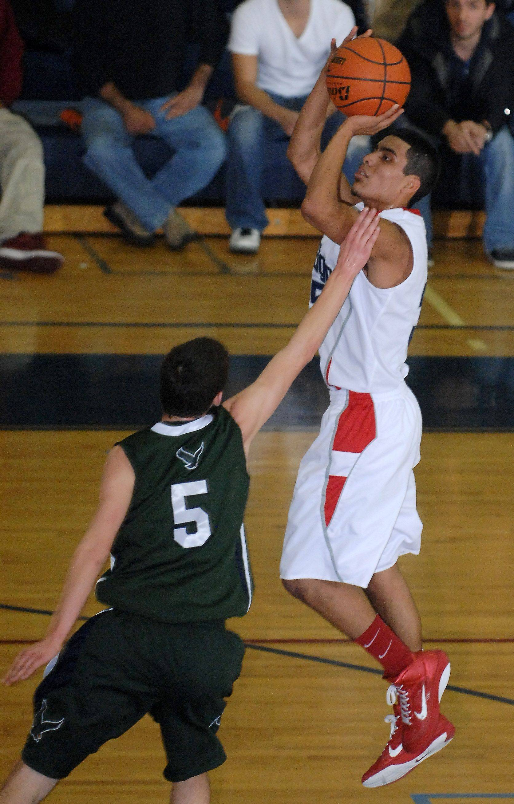 South Elgin's Martin Duarte scores over Bartlett's Matt Chaltin during Friday's game at South Elgin.