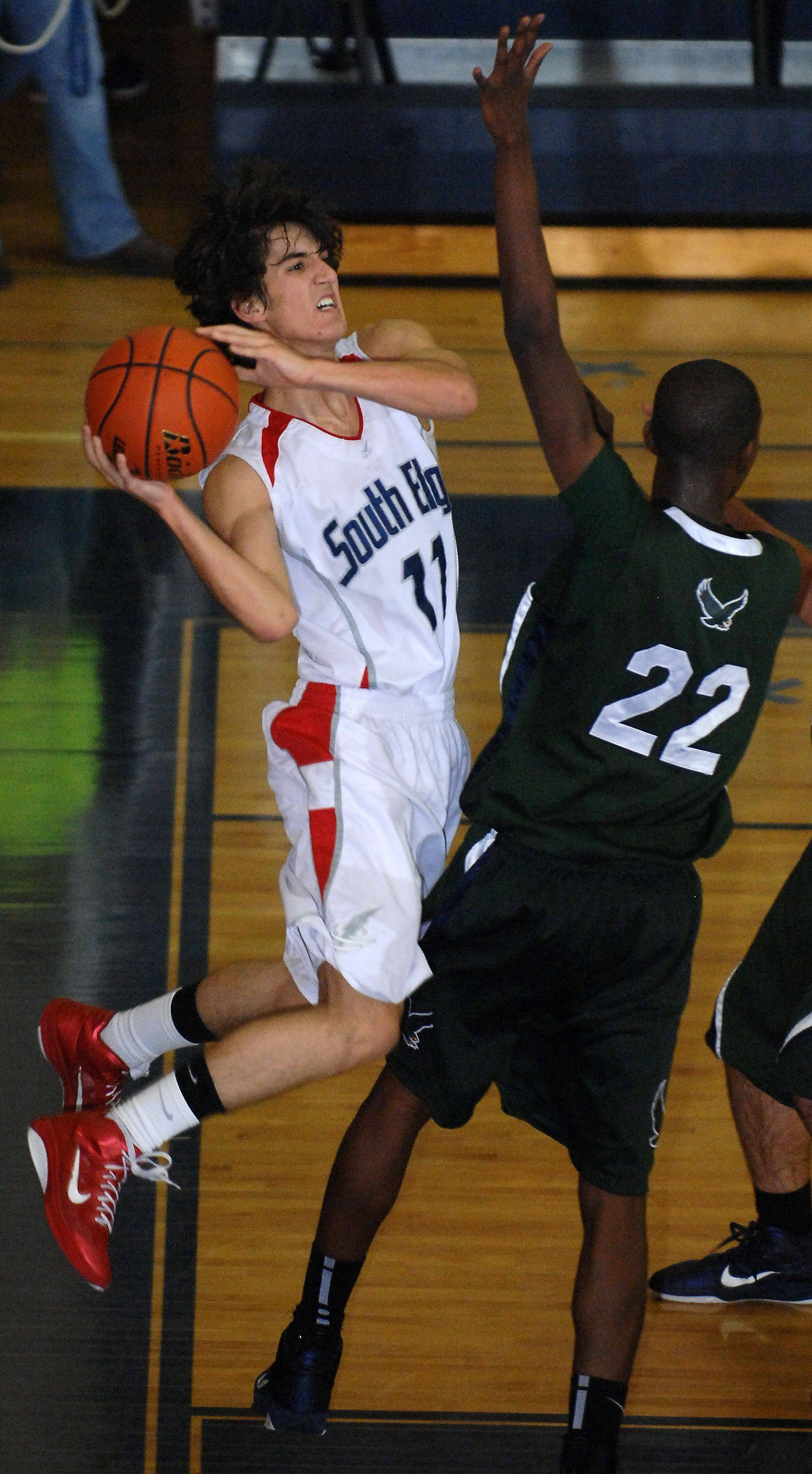 South Elgin's Sammy Sutter is fouled going to the basket by Bartlett's Femi Oyewole.