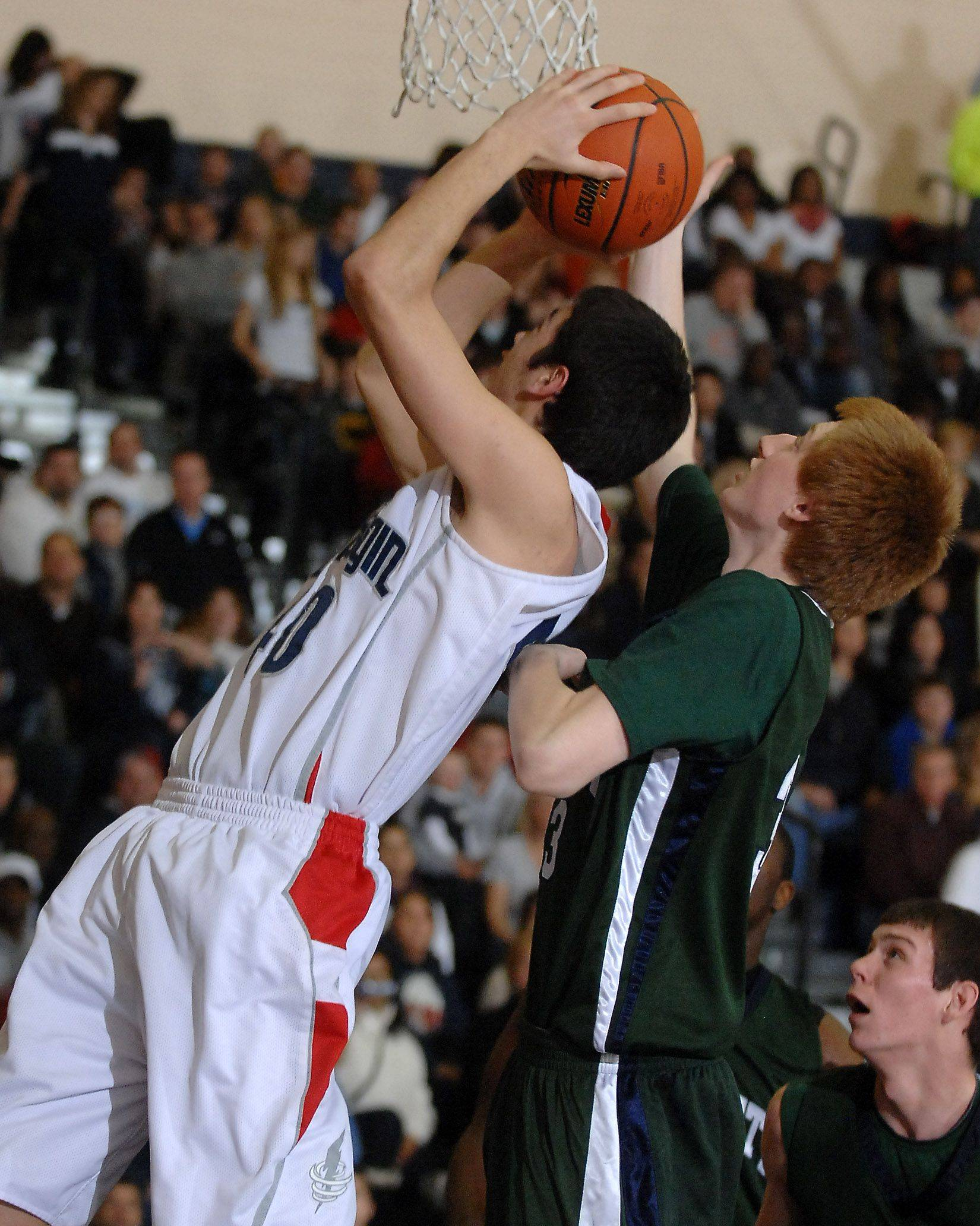 Bartlett's Joe Sabatino blocks the shot of South Elgin's Matthew Downing.