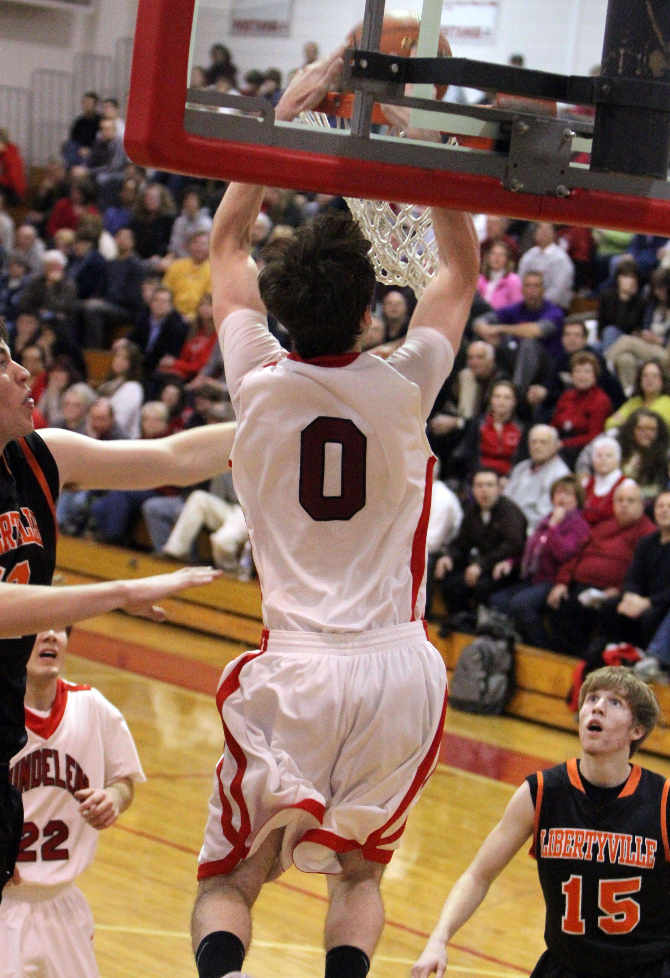 Mundelein's Ryan Sawvell dunks the ball a second time in the third quarter.