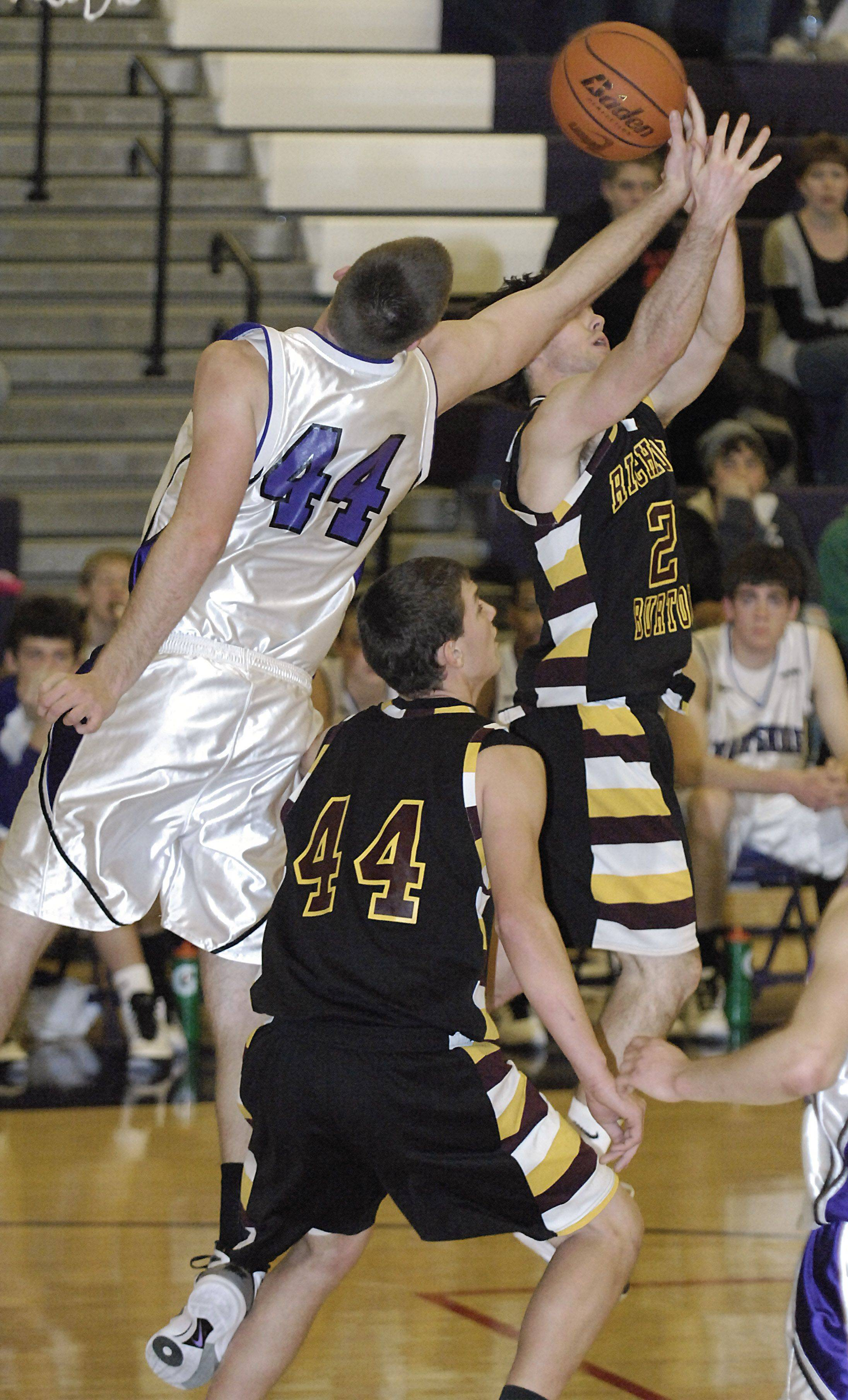 Hampshire's Tyler Watzlawick swipes a rebound from Richmond's Brandon Kinsella in the third quarter on Saturday, January 8.