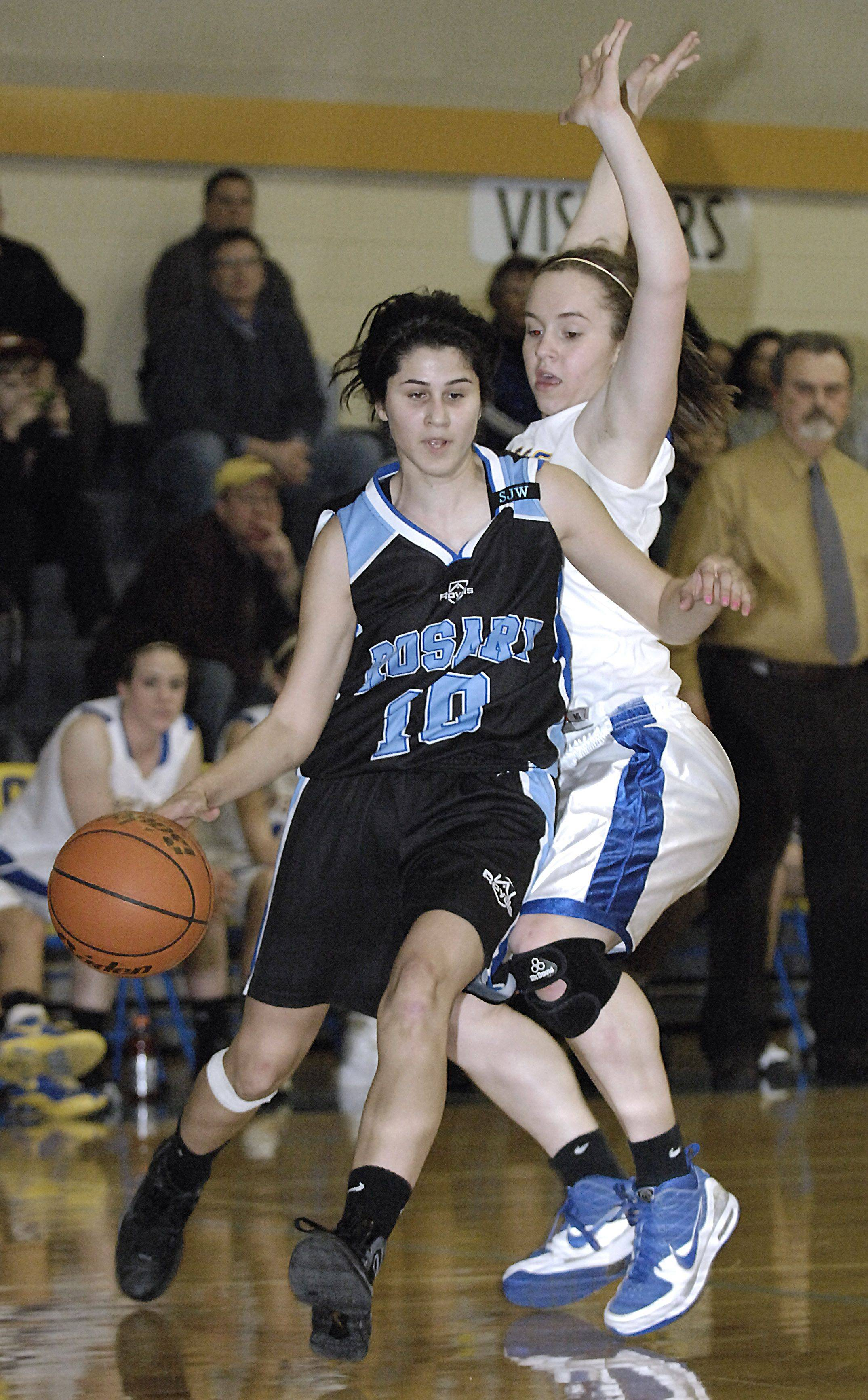 Rosary's Brenda Rocha circles past Aurora Central's Ashley Wilk in the first quarter.