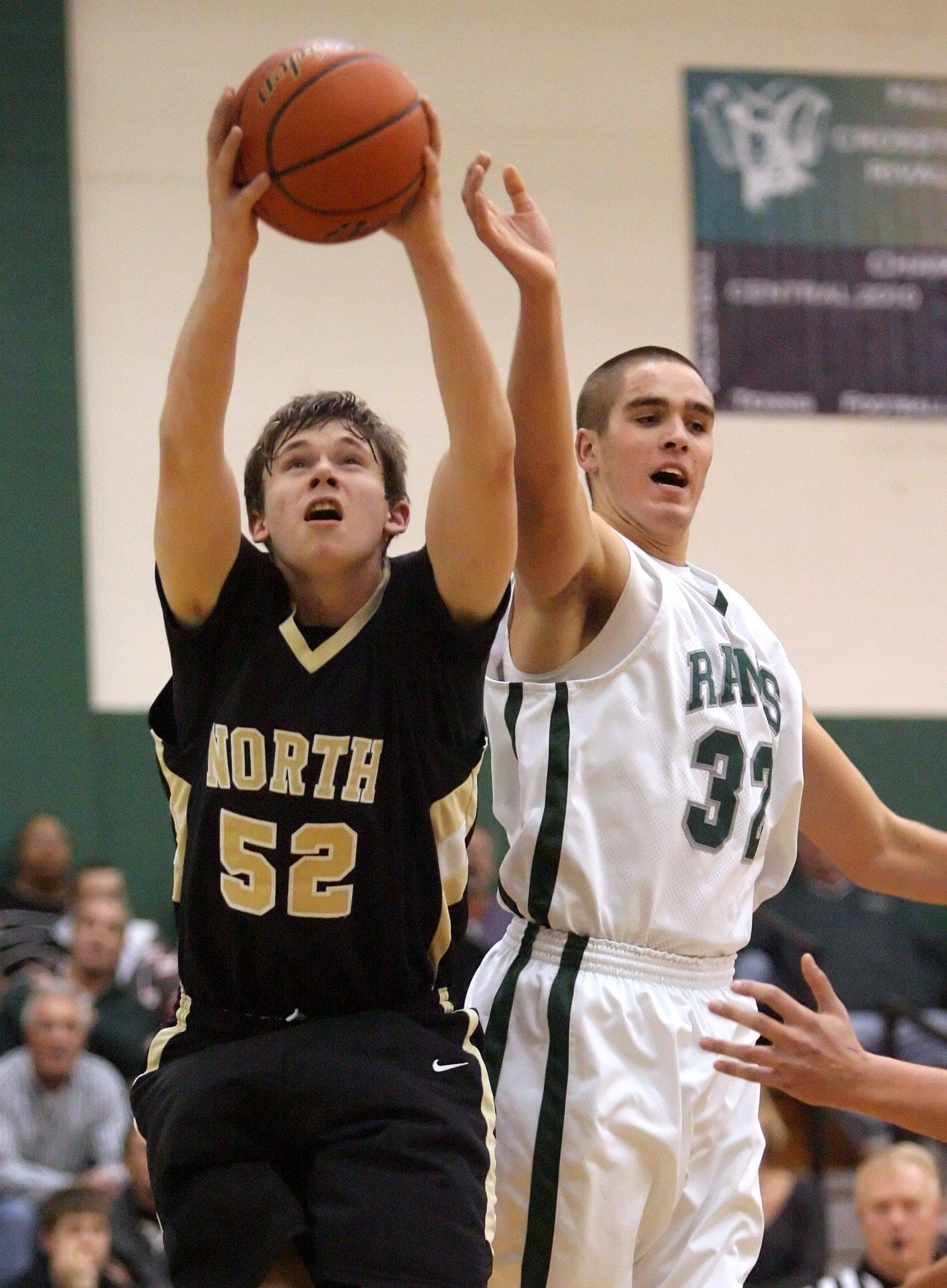 Grayslake North's David Sparks, left, and Grayslake Central's Casey Boyle fight for a rebound .