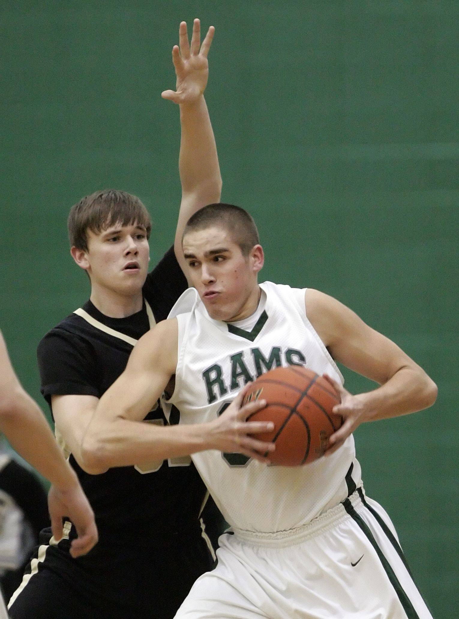 Grayslake Central's Casey Boyle, right, drives on Grayslake North's David Sparks.