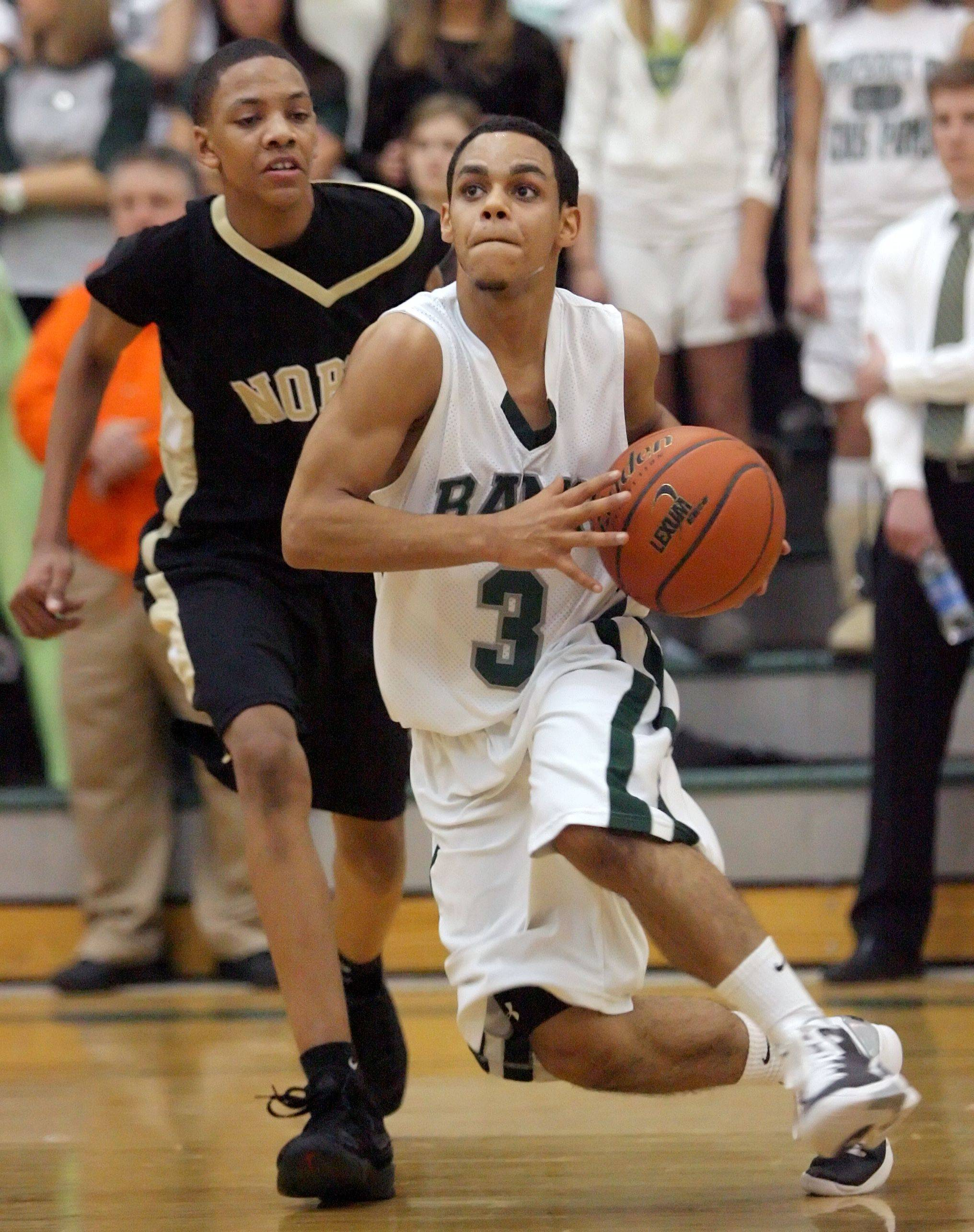 Grayslake Central's Jordan Taylor, right, drives past Grayslake North's Mark Hall .