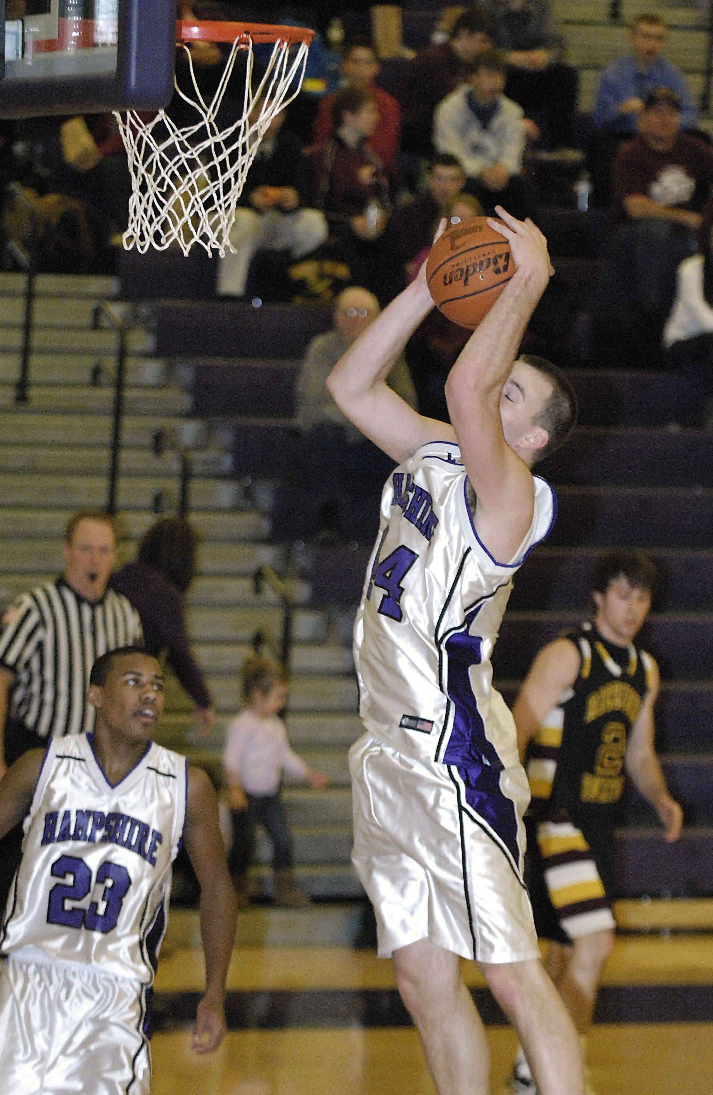 Hampshire's Tyler Watzlawick grabs a rebound in the second quarter of game vs. Richmond on Saturday, January 8.