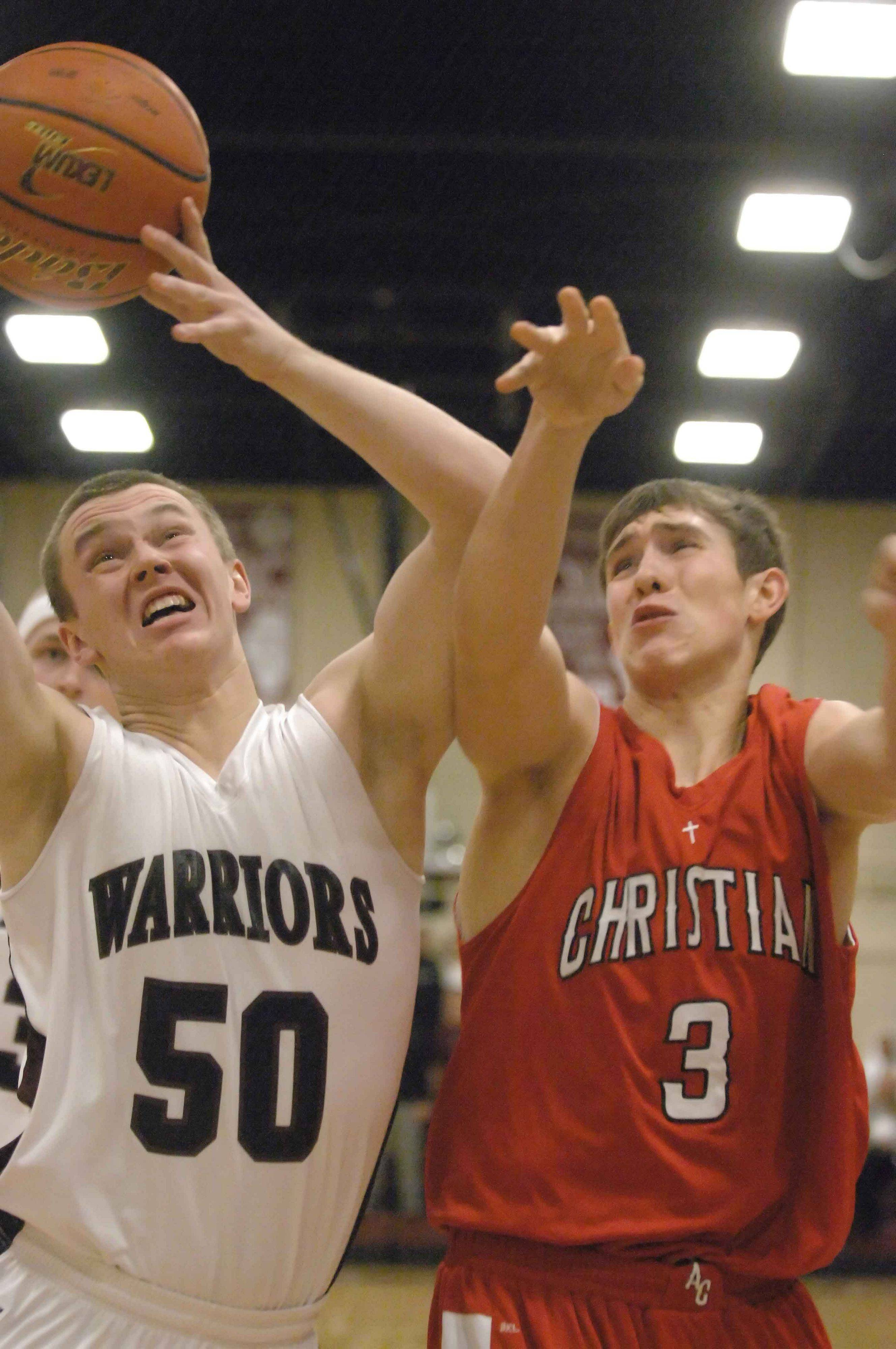 Tate Fritz ,left, of Wheaton Academy and CJ Schutt of Aurora Christian.
