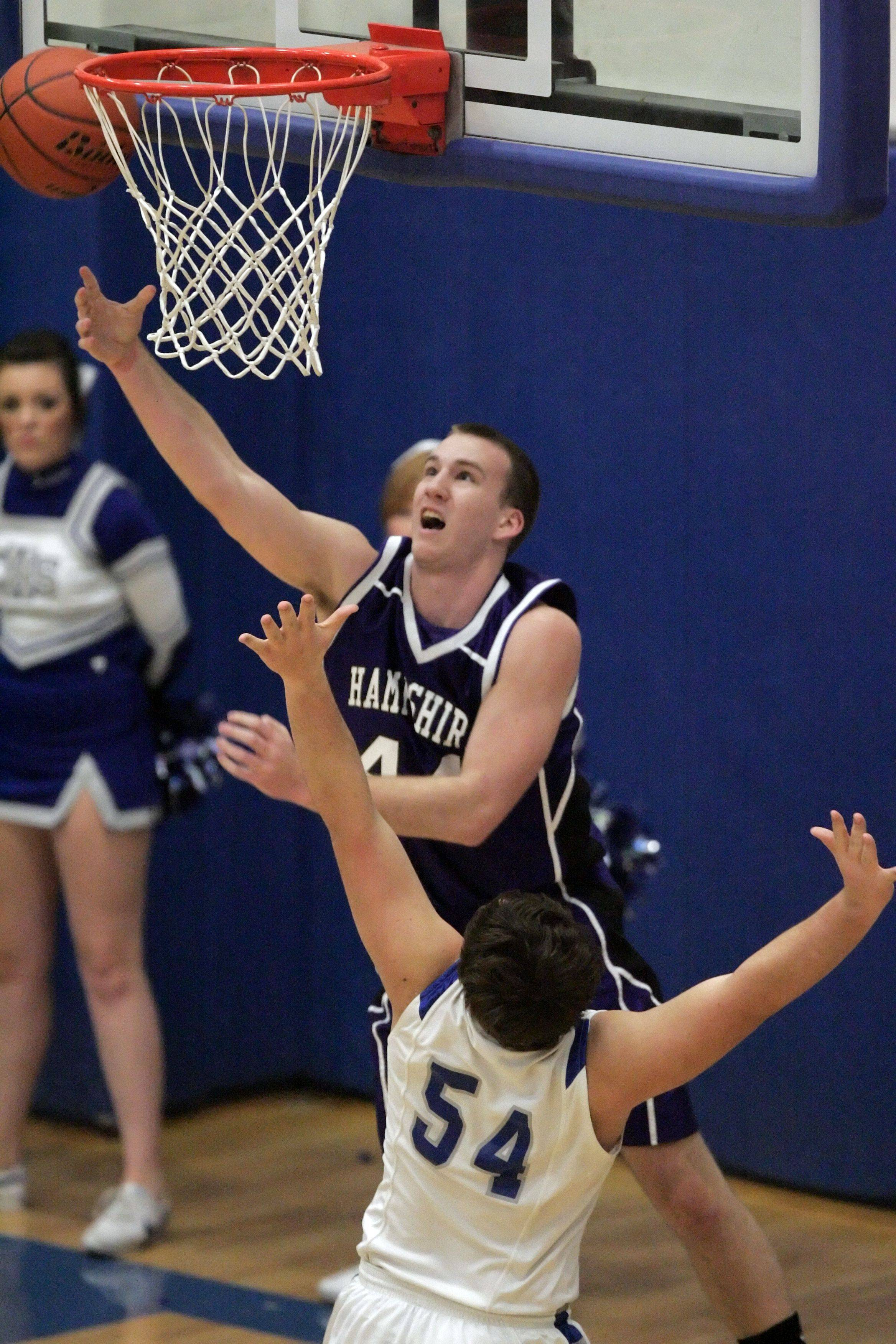 Hampshire forward Tyler Watzlawick, 44, goes to the hoop over Burlington Central forward Joel Lopez.