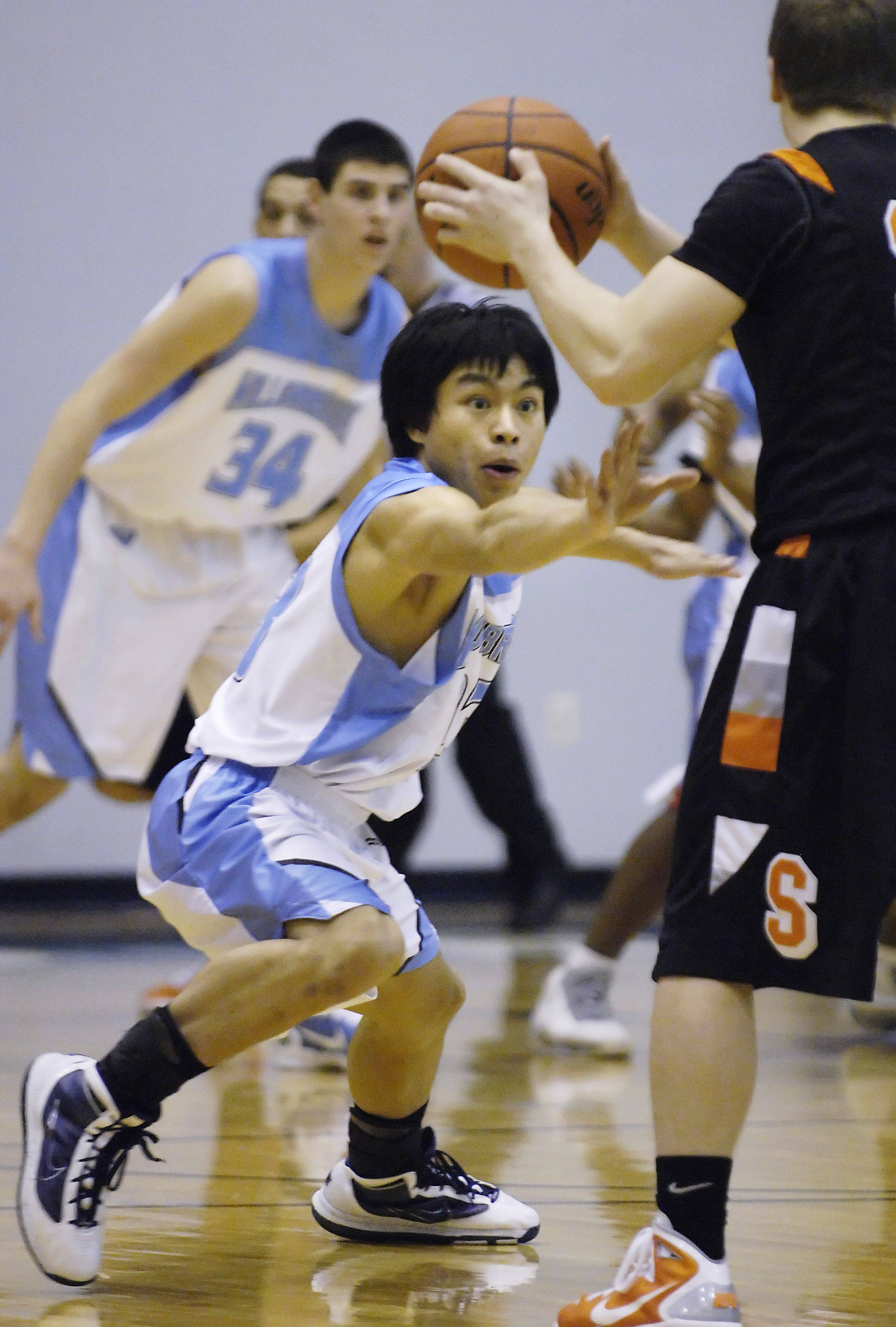 Willowbrook's Raphael Garcia defends St. Charles East's Zach Zajicek.