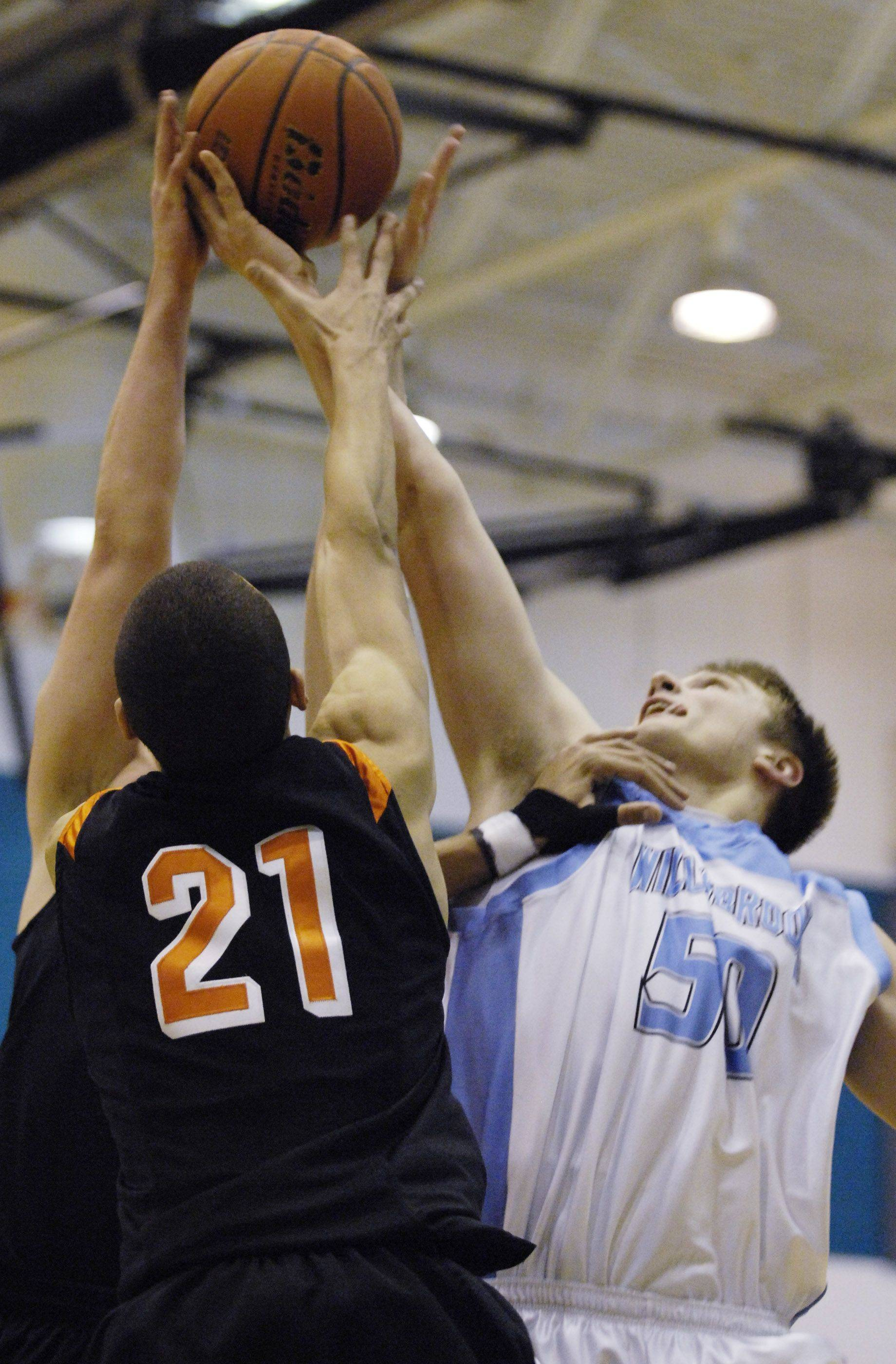 Images from the St. Charles East vs. Willowbrook boys basketball game at the Woodstock North MLK Shootout Monday, January 17, 2011.