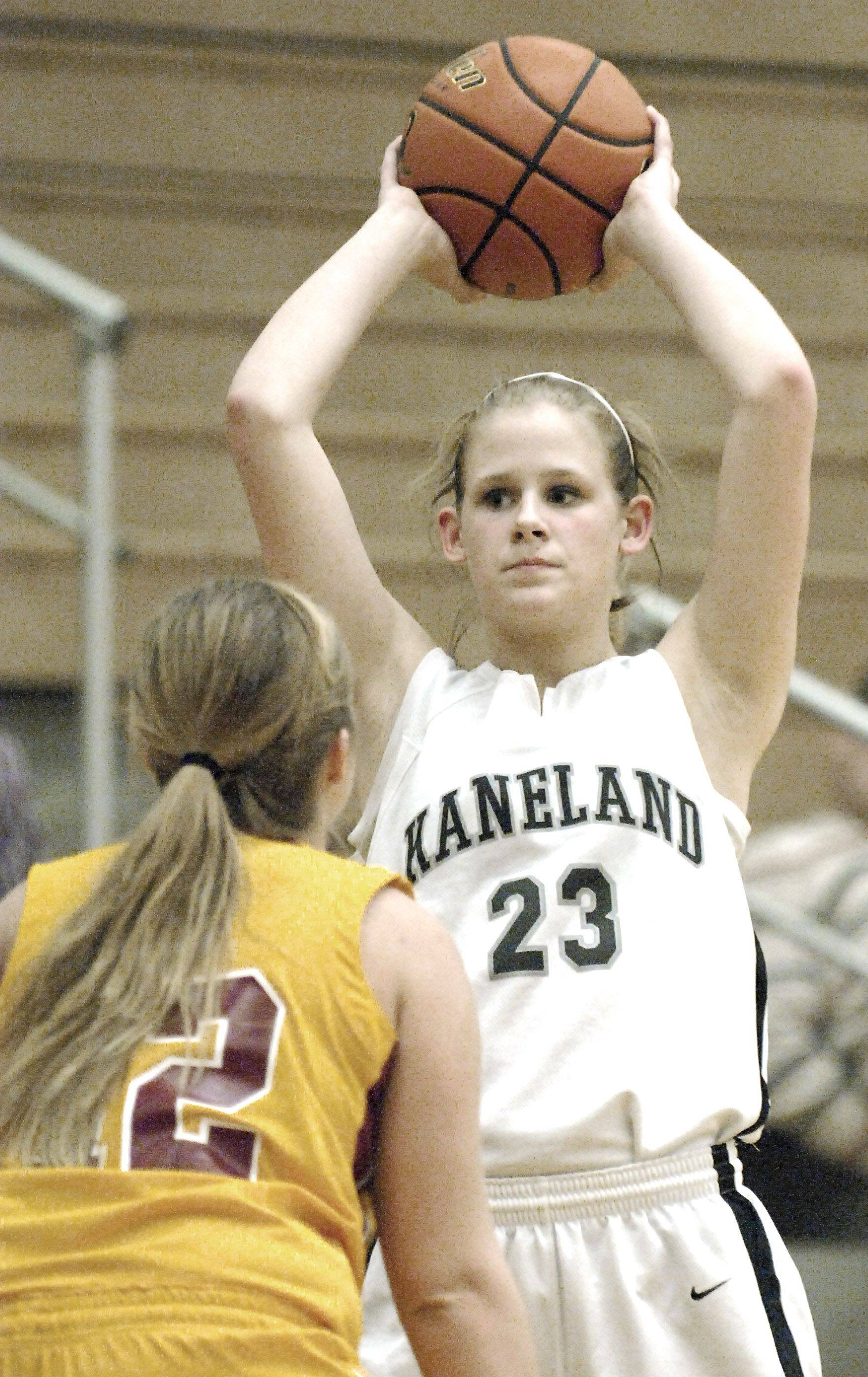 Kaneland's Tesa Alderman looks to pass over Morris' Layney Miller in the fourth quarter .