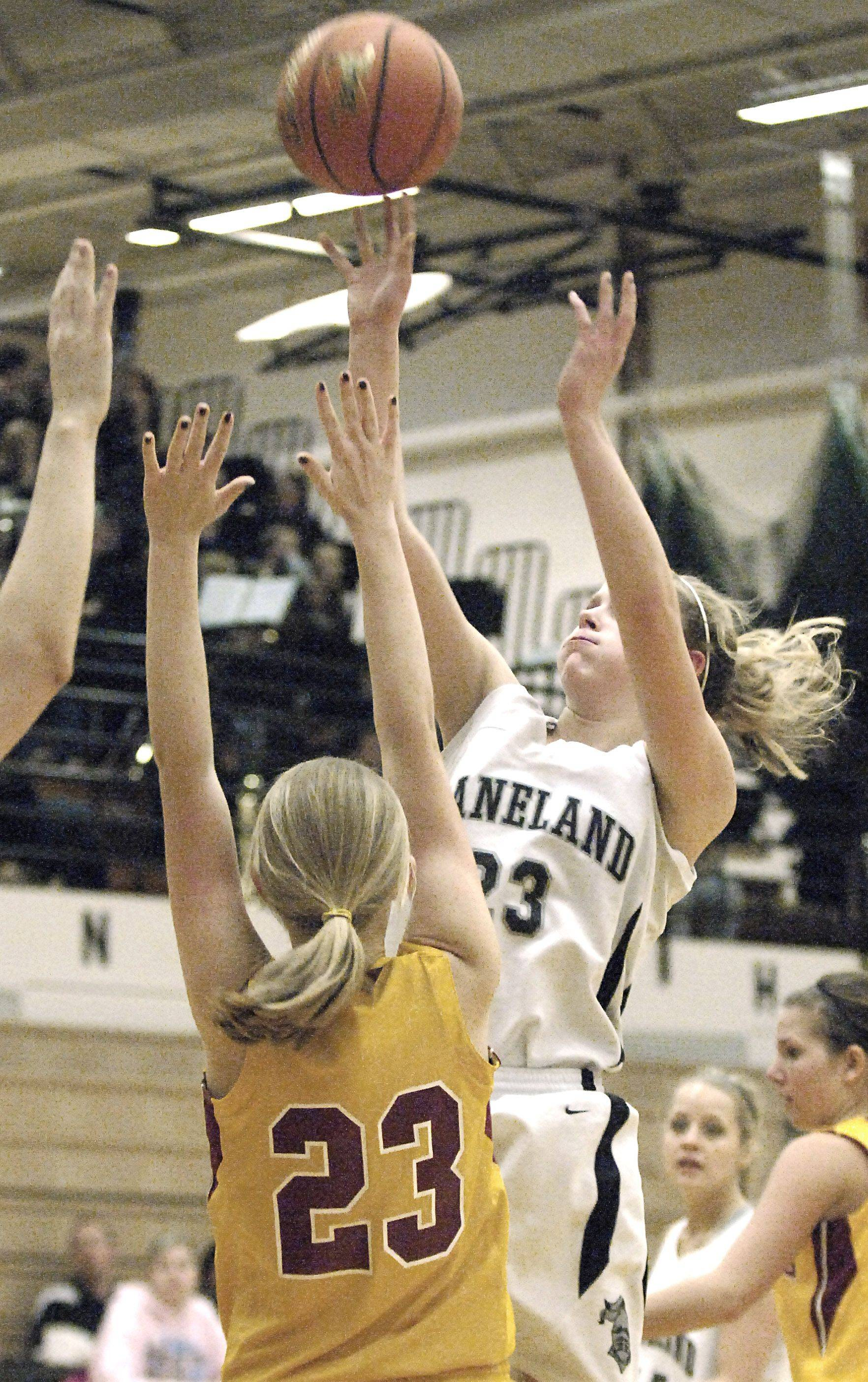 Kaneland's Tesa Alderman shoots over Morris' Alex Granger in the first quarter.