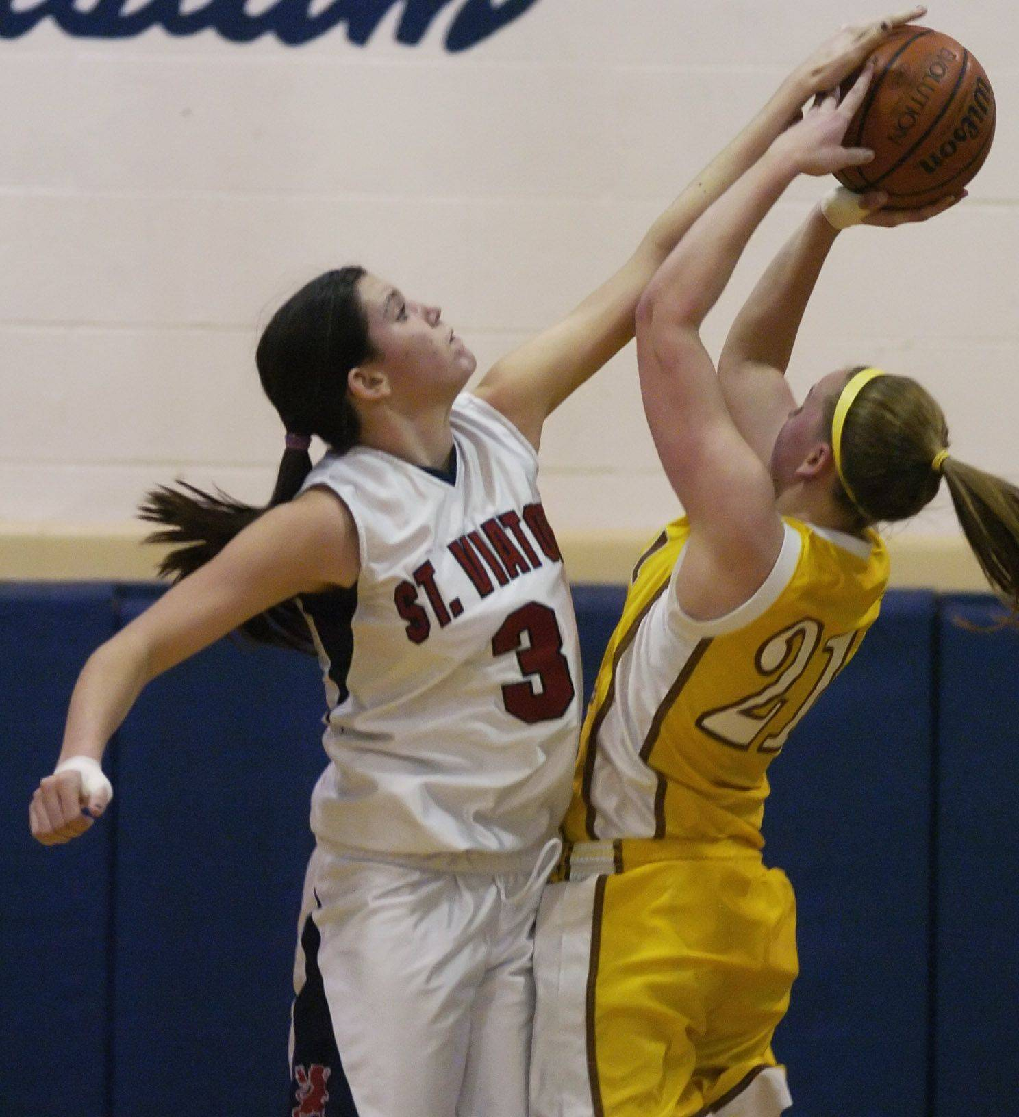 St. Viator's Lauren Rooney blocks a shot by Carmel's Sarah McHugh during Wednesday's game.