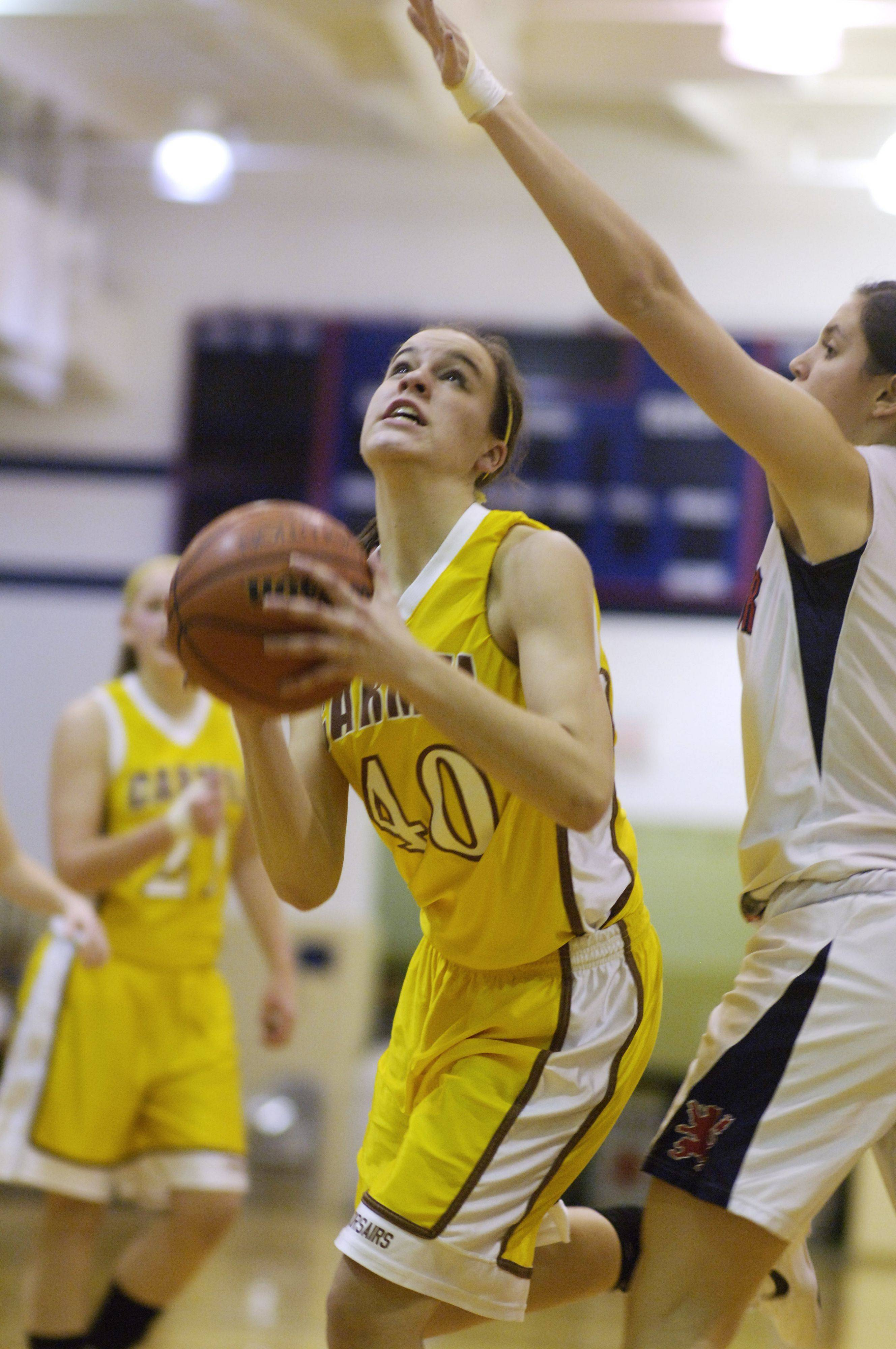 Carmel's Kaitlyn Lynch makes a move toward the basket during Wednesday's game at St. Viator.