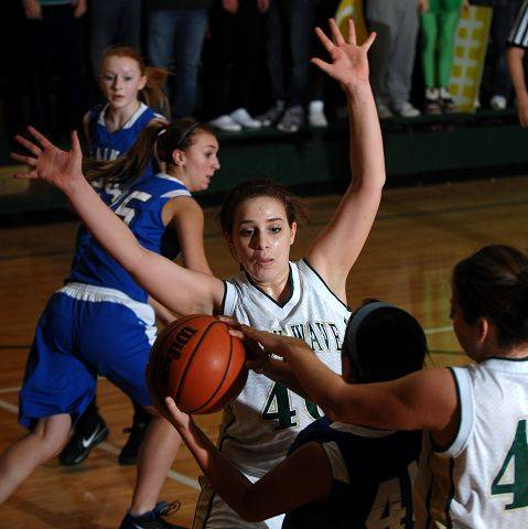 St. Edward's Katherine VonAhnen and Madeline Kerr, right, harass St. Francis's Morgan Connelly as she looks for an open teammate .