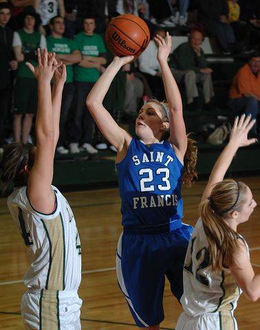 St. Francis' Kelly Reinke takes a shot between two St. Edward's defenders.