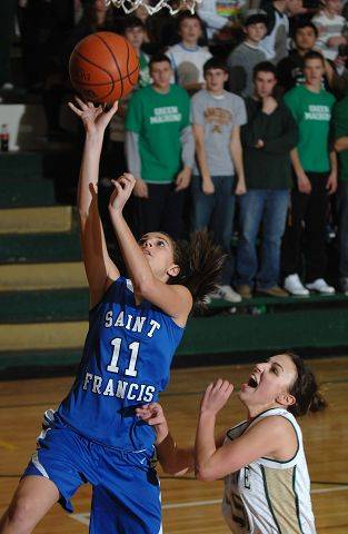 St. Francis's Aly Germanos drives to the hoop against St. Edward.