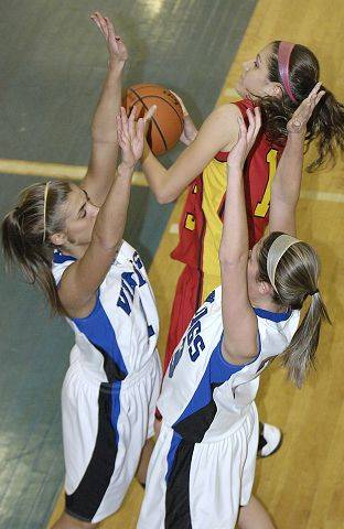 Batavia's Miranda Grizaffi is swarmed by Geneva's Brooke Binette, left, and Katelyn Allen in the first quarter .