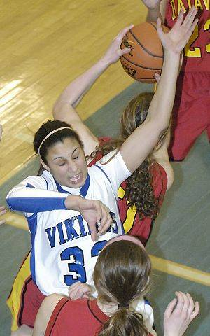 Batavia's Maddie Sychta swipes a rebound from Geneva's Ashley Santos in the second quarter.