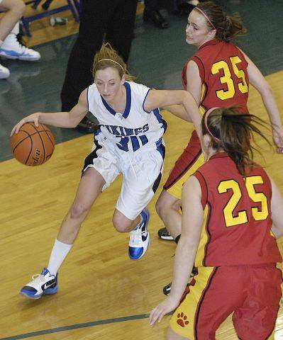 Geneva's Dori Rogers weaves around a block by Batavia's Michaela Strehlau in the fourth quarter.