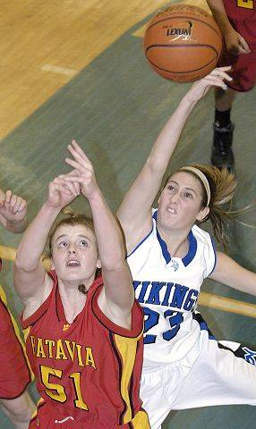 Batavia's Katie Ryan battles for a rebound with Geneva's Katelyn Allen in the second quarter.