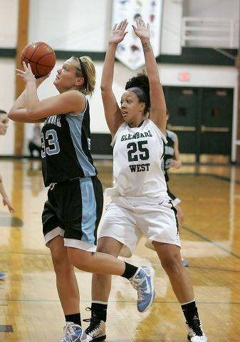 Jenna Dalton of Willowbrook moves in front of Shanice Hayes of Glenbard West to shoot a a basket in girls basketball action Tuesday in Glen Ellyn.