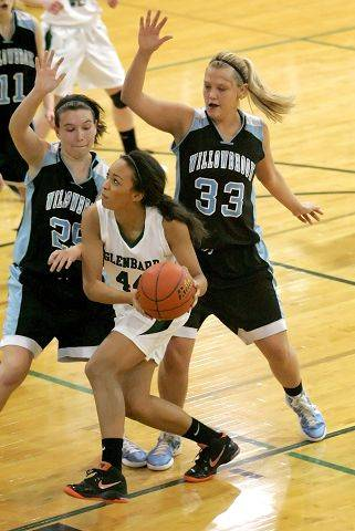Becca Folan of Glenbard West looks for room to shoot as Colleen Lydon, left and Jenna Dalton, right of Willowbrook defend in girls basketball action Tuesday in Glen Ellyn.