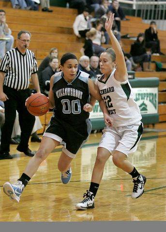 Anita Sterling of Willowbrook, left, moves around Lauren Davis of Glenbard West.
