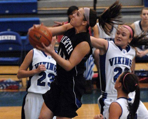 St. Charles North guard Tess Fischer drives to the basket against Geneva during Thursday's game in Geneva.