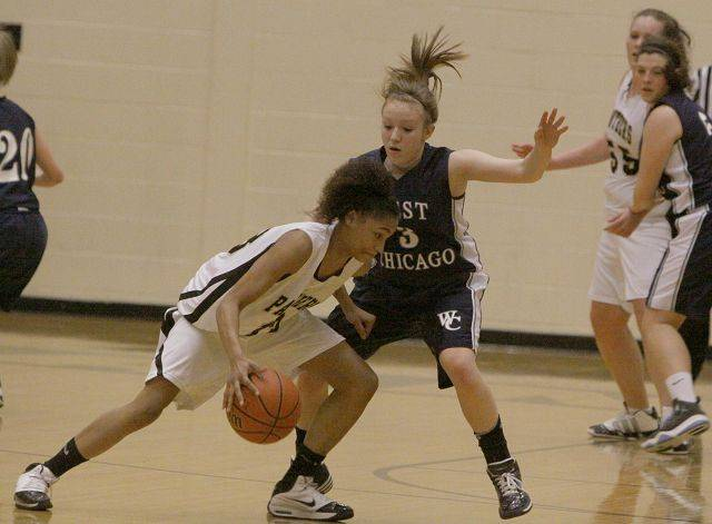 Glenbard North's Kailey James tries to get past West Chicago's Claire Monroe.