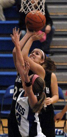 St. Charles North forward Leah Horton shoots over Geneva's Katelyn Allen.