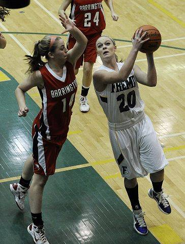Barrington's Brooke Chandor comes with the block and a foul against Fremd's Carrie Wagner.