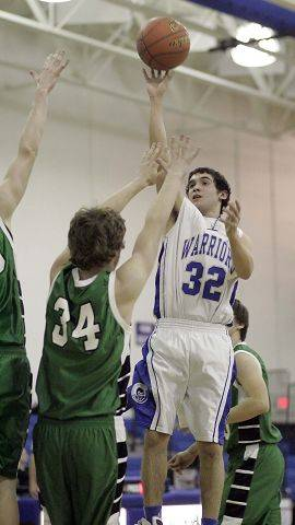 Westminster Christian's Brandon Cork shoots over Hebron's Alex Arthur.