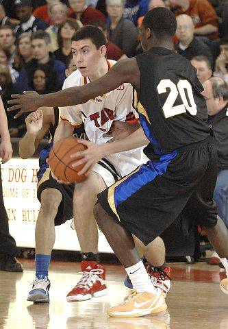 Batavia's Jesse Coffey looks to get past a block by Simeon's Kendrick Nunn in the first half on Saturday, February 5.