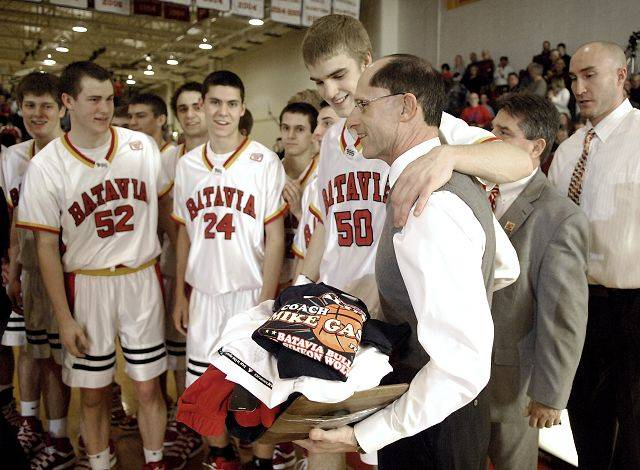 Laura Stoecker/lstoecker@dailyherald.comSenior Elliot Vaughn puts his arm around Batavia athletic director Mike Gaspari after being presented with tshirts and other items in recognition of his upcoming retirement before the start of their Night of Hoops game on Saturday, February 5.
