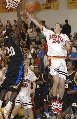 Batavia's Jesse Coffey sinks a shot over Simeon's Kendrick Nunn in the second half on Saturday, February 5.