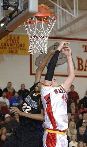 Batavia's Cole Gardner and Simeon's Rashawn McElrath leap up for a rebound in the first quarter on Saturday, February 5.