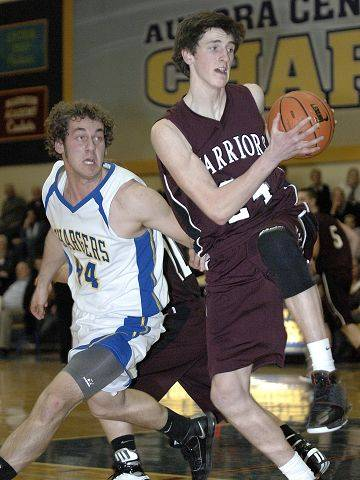 Wheaton Academy's Luke Thorson grabs a rebound ahead of Aurora Central's Kent Brauweiler in the fourth quarter.